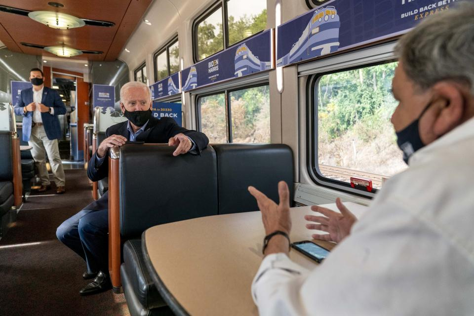 Democratic presidential candidate former Vice President Joe Biden speaks with United Steelworkers Union President Thomas Conway, right, aboard his train as it travels to Pittsburgh, Wednesday, Sept. 30, 2020. Biden is on a train tour through Ohio and Pennsylvania today. (AP Photo/Andrew Harnik)