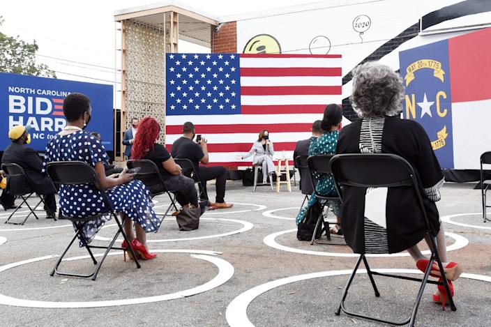 <p>Harris continued to campaign both alongside and apart from Biden, even as the ongoing coronavirus pandemic meant that those events were socially distanced and smaller. Here, she speaks outside Whites Barbershop in Raleigh, North Carolina, in September 2020. </p>