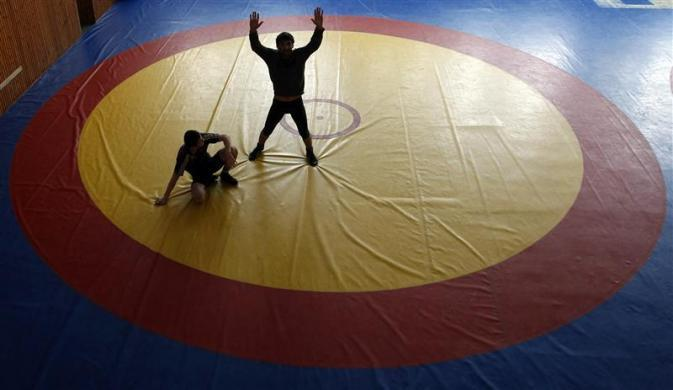 Freestyle wrestlers take part in a training session at a sport base in Makhachkala, the capital of Russia's North Caucasus republic of Dagestan, March 23, 2012.