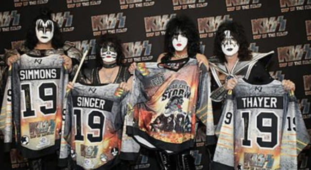 Members of KISS with the jerseys that the Quad City Storm will be wearing for a promotional night honouring the legendary band on Saturday. (Twitter//@SPHL)
