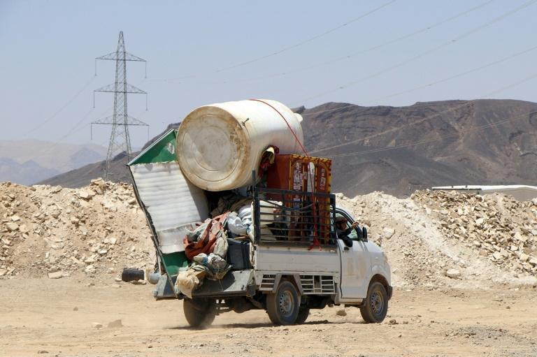 A car loaded with a cistern, a closet, and a TV at a camp for the internally displaced on the Marib's outskirts on March 28