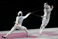 Pauline Ranvier of France, left, and Marta Martyanova of the Russian Olympic Committee compete in the women's Foil team final at the 2020 Summer Olympics, Thursday, July 29, 2021, in Chiba, Japan. (AP Photo/Andrew Medichini)
