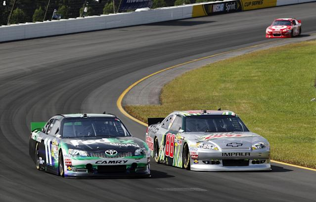 Dale Earnhardt Jr., (88) races side-by-side with Denny Hamlin (11) as Juan Pablo Montoya (42) follows during the NASCAR Sprint Cup Series auto race, Sunday, Aug. 5, 2012, at Pocono Raceway in Long Pond, Pa. (AP Photo/Mel Evans)