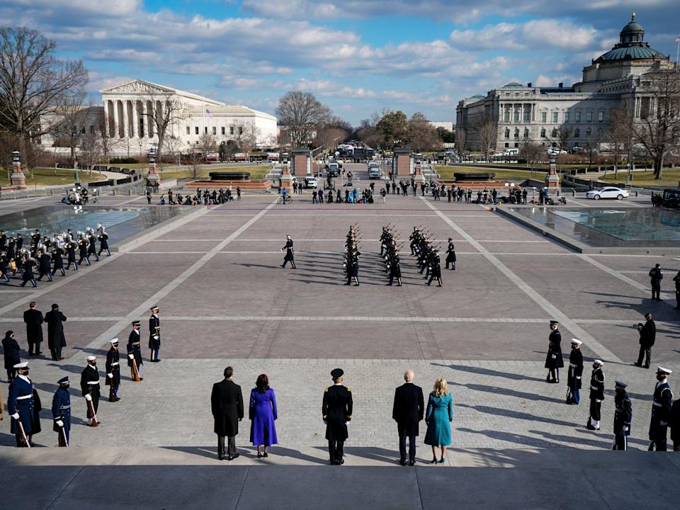 Joe Biden, Jill Biden, Kamala Harris, and Doug Emhoff depart the East Front of the Capitol at the conclusion of the inauguration ceremonies for the Pass in Review with members of the militaryAP