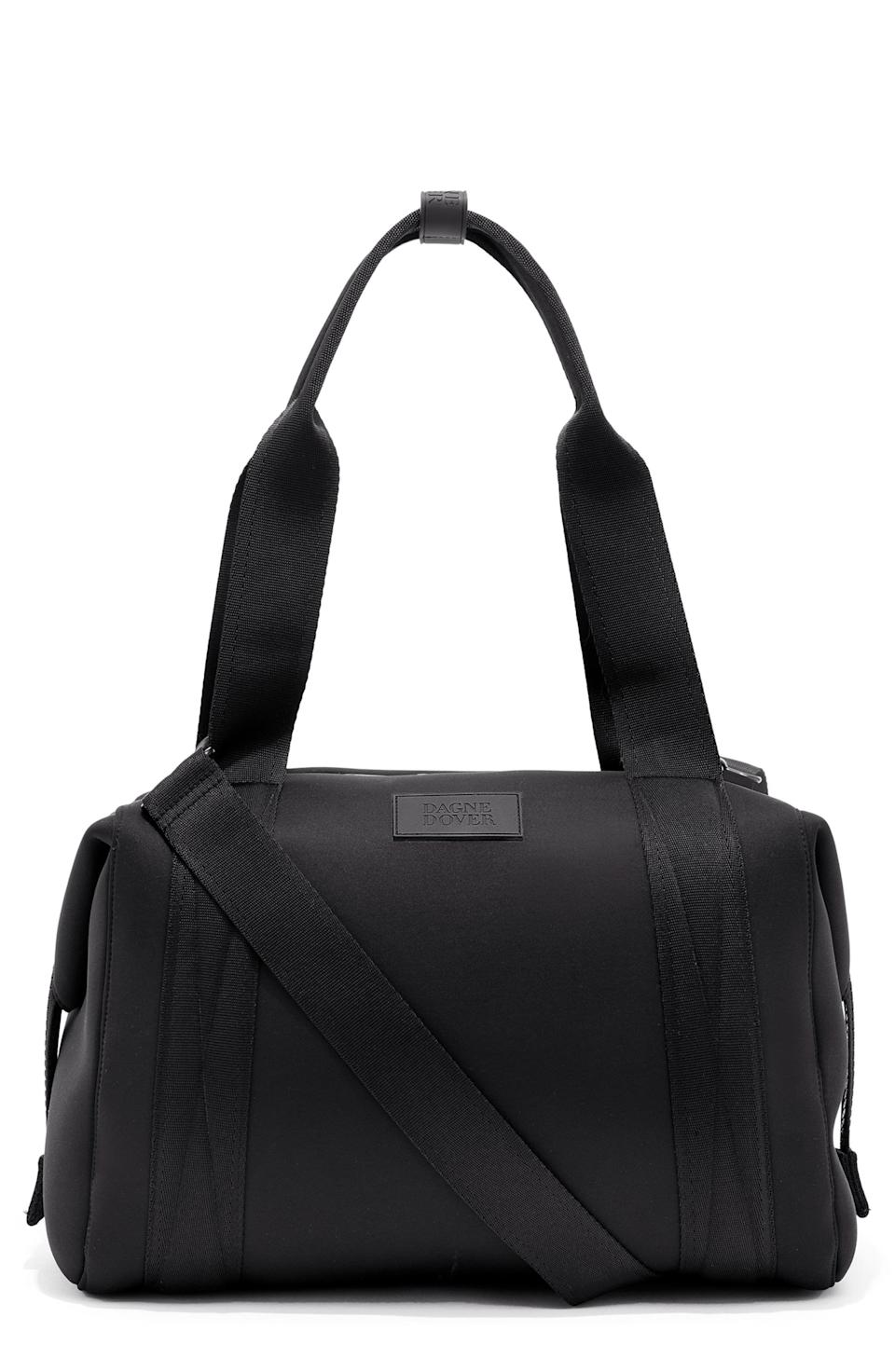 """<p><strong>Dagne Dover</strong></p><p>nordstrom.com</p><p><strong>$155.00</strong></p><p><a href=""""https://go.redirectingat.com?id=74968X1596630&url=https%3A%2F%2Fwww.nordstrom.com%2Fs%2Fdagne-dover-medium-landon-neoprene-carryall-duffle-bag%2F5327370&sref=https%3A%2F%2Fwww.harpersbazaar.com%2Fbeauty%2Fhealth%2Fg23900366%2Fbest-fitness-gifts-ideas%2F"""" rel=""""nofollow noopener"""" target=""""_blank"""" data-ylk=""""slk:Shop Now"""" class=""""link rapid-noclick-resp"""">Shop Now</a></p><p>Not only does this neoprene duffel look good, it also has a zillion compartments to store everything one could possibly need to work out—including a removable shoe bag.</p>"""