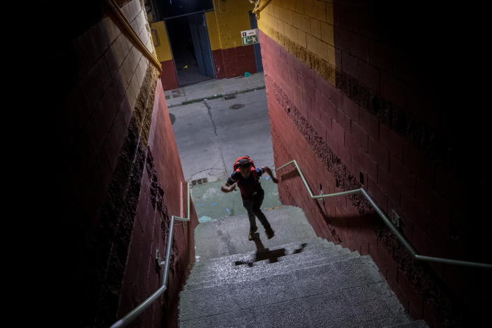 A migrant runs after crossing into the Spanish enclave of Ceuta, near the border of Morocco and Spain, early Wednesday, May 19, 2021. (AP Photo/Bernat Armangue)