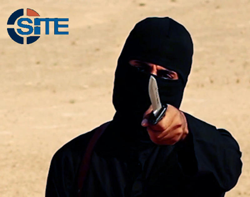 "A masked, black-clad militant, who has been identified by the Washington Post newspaper as a Briton named Mohammed Emwazi, brandishes a knife in this still image from a 2014 video obtained from SITE Intel Group February 26, 2015. Investigators believe that the masked killer known as ""Jihadi John"", who fronted Islamic State beheading videos, is Emwazi, two U.S. government sources said on Thursday. The British government and police refused to confirm or deny his identity, which was first revealed by the Washington Post, saying it was an ongoing security investigation. REUTERS/SITE Intel Group/Handout via Reuters (CIVIL UNREST POLITICS CRIME LAW CONFLICT) ATTENTION EDITORS - THIS PICTURE WAS PROVIDED BY A THIRD PARTY. REUTERS IS UNABLE TO INDEPENDENTLY VERIFY THE AUTHENTICITY, CONTENT, LOCATION OR DATE OF THIS IMAGE. FOR EDITORIAL USE ONLY. NOT FOR SALE FOR MARKETING OR ADVERTISING CAMPAIGNS. THIS PICTURE WAS PROCESSED BY REUTERS TO ENHANCE QUALITY. AN UNPROCESSED VERSION WILL BE PROVIDED SEPARATELY"