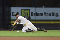 San Diego Padres left fielder Tommy Pham can't make a diving catch on a hit by Colorado Rockies' Charlie Blackmon during the fourth inning of a baseball game Thursday, July 29, 2021, in San Diego. (AP Photo/Derrick Tuskan)
