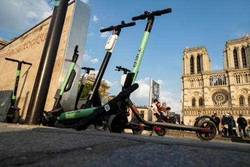 Electric scooters parked in front of Notre-Dame cathedral in Paris