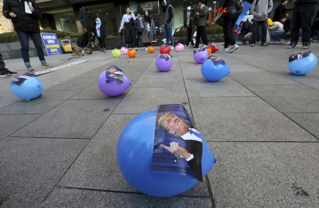 <p>Balloons attached pictures of the President Donald Trump are displayed during a rally to oppose his planned visit near the U.S. Embassy in Seoul, South Korea, Saturday, Nov. 4, 2017. (Photo: Ahn Young-joon/AP) </p>