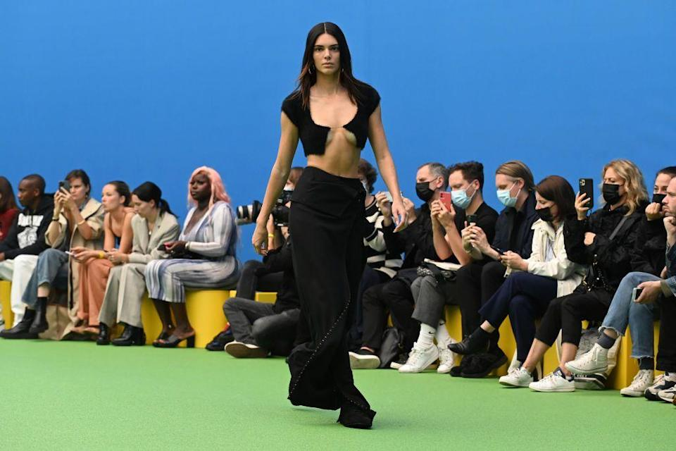 <p>The brunette wore two looks in the show, including this black, barely-there cropped cardigan and long skirt.</p>