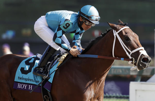 Paco Lopez rides Roy H to victory in Breeders' Cup Sprint horse race at Churchill Downs, Saturday, Nov. 3, 2018, in Louisville, Ky. (AP Photo/Darron Cummings)