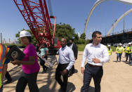 District of Columbia Mayor Muriel Bowser, left, and Secretary of Transportation Pete Buttigieg, right, visit the Frederick Douglass Memorial Bridge construction site in together with Secretary of Labor Marty Walsh, in southeast Washington, Wednesday, May 19, 2021. (AP Photo/Manuel Balce Ceneta)