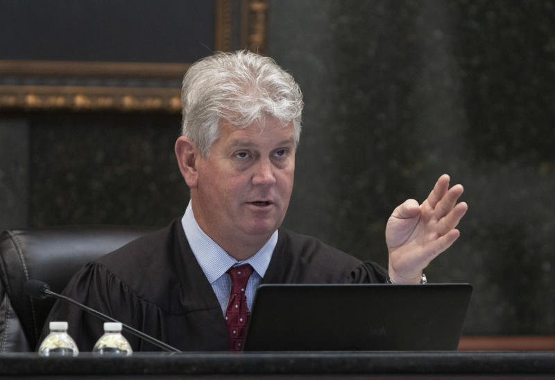 State Judge Eugene Griffith talks to attorneys during the trail of Timothy Jones Jr. in Lexington, S.C., Wednesday, May 22, 2019. Lawyers defending Jones turned Wednesday to brain science in an effort to spare their client from the death penalty. (Tracy Glantz/The State via AP, Pool)
