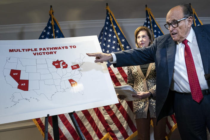 Rudy Giuliani points to a map as he speaks to the press about various lawsuits related to the 2020 election,  inside the Republican National Committee headquarters on November 19, 2020 in Washington, DC. (Drew Angerer/Getty Images)
