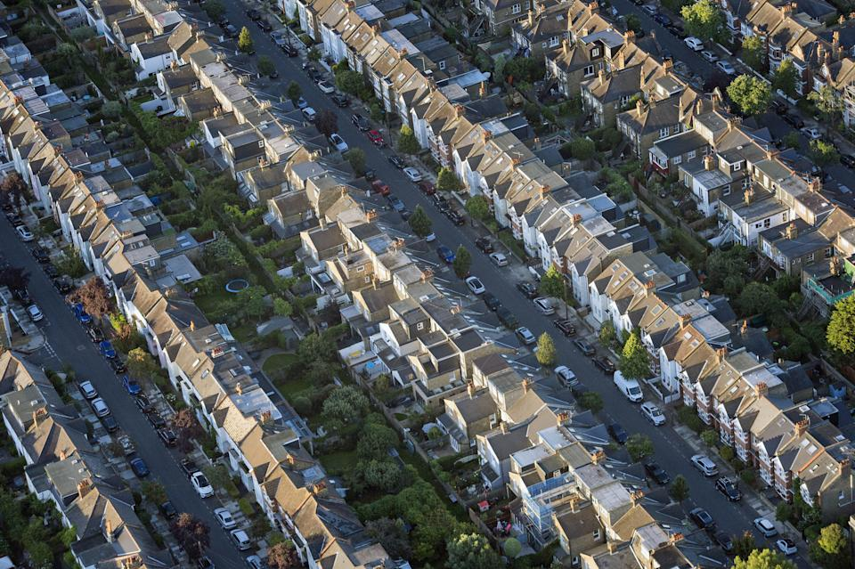 """Undated file photo of terraced houses. The property market is ending 2020 on a """"sprint finish"""", with the average price tag on a home nearly GBP 20,000 higher than it was at the start of the year, despite the economic fallout from the coronavirus crisis."""