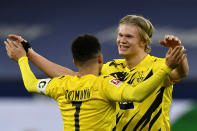 Dortmund's Erling Haaland celebrates with Jadon Sancho, left,at the end of the German Bundesliga soccer match between FC Schalke 04 and Borussia Dortmund in Gelsenkirchen, Germany, Saturday, Feb. 20, 2021. Haaland scored twice and Sancho once in Dortmund's 4-0 win. (AP Photo/Martin Meissner, Pool)