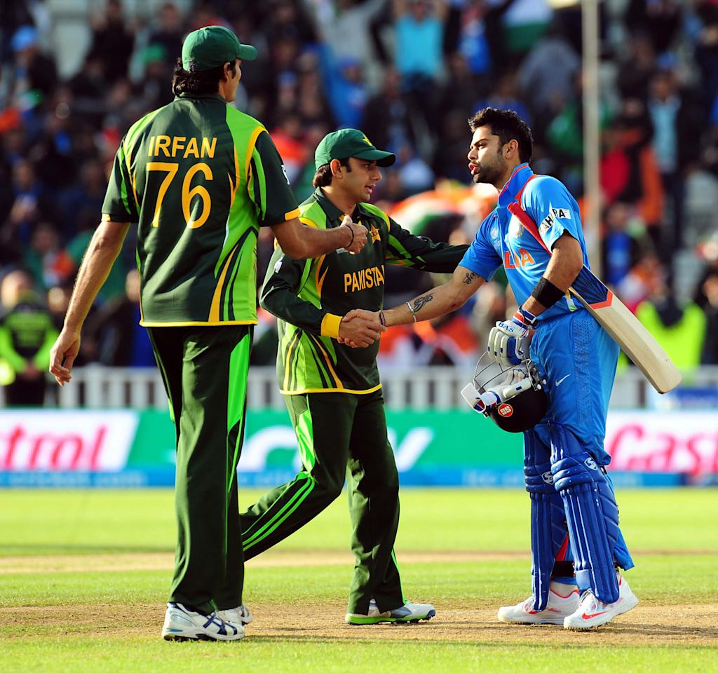 India's Virat Kohli shakes hands with Saeed Ajmal and Mohammad Irfan after hitting the winning run during the ICC Champions Trophy match at Edgbaston, Birmingham.