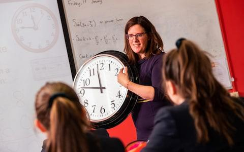 In a digital age school children are struggling to tell the time on traditional clock faces and watches - Credit: Stuart Nicol/The Telegraph