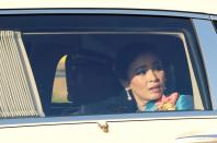 FILE PHOTO: Thailand's King Maha Vajiralongkorn and Queen Suthida are pictured as the motorcade drives towards the Grand Palace in Bangkok