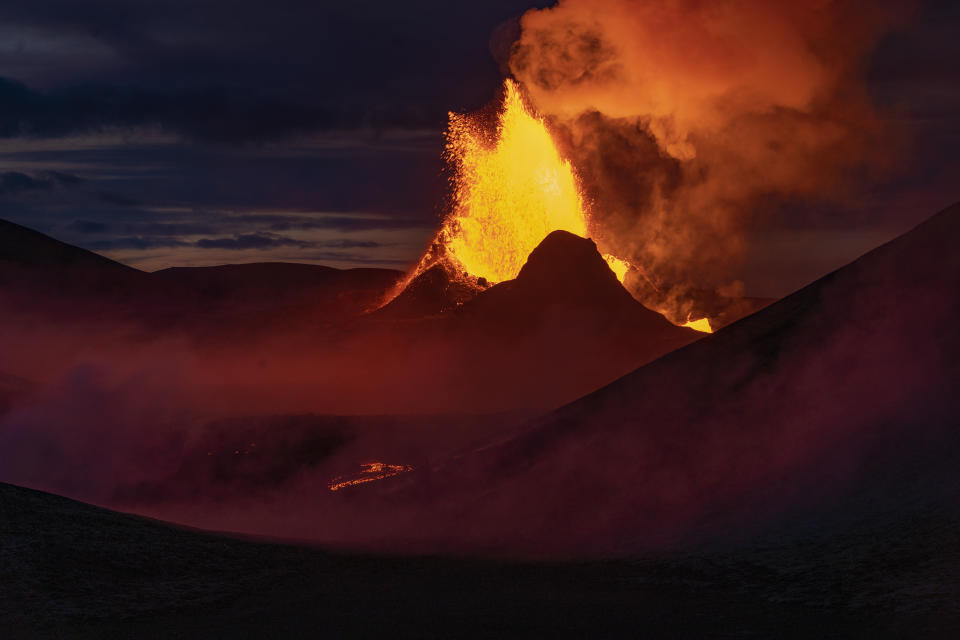 Lava flows from an eruption of the Fagradalsfjall volcano on the Reykjanes Peninsula in southwestern Iceland on Wednesday, May 12, 2021. The glow from the bubbling hot lava spewing out of the Fagradalsfjall volcano can be seen from the outskirts of Iceland's capital, Reykjavík, which is about 32 kilometers (20 miles) away. Pandemic or no pandemic, the world will never stand still. That's perhaps no clearer than in Iceland where the Fagradalsfjall volcano has awoken from a slumber that has lasted 6,000 years, give or take a year or two. (AP Photo/Miguel Morenatti)