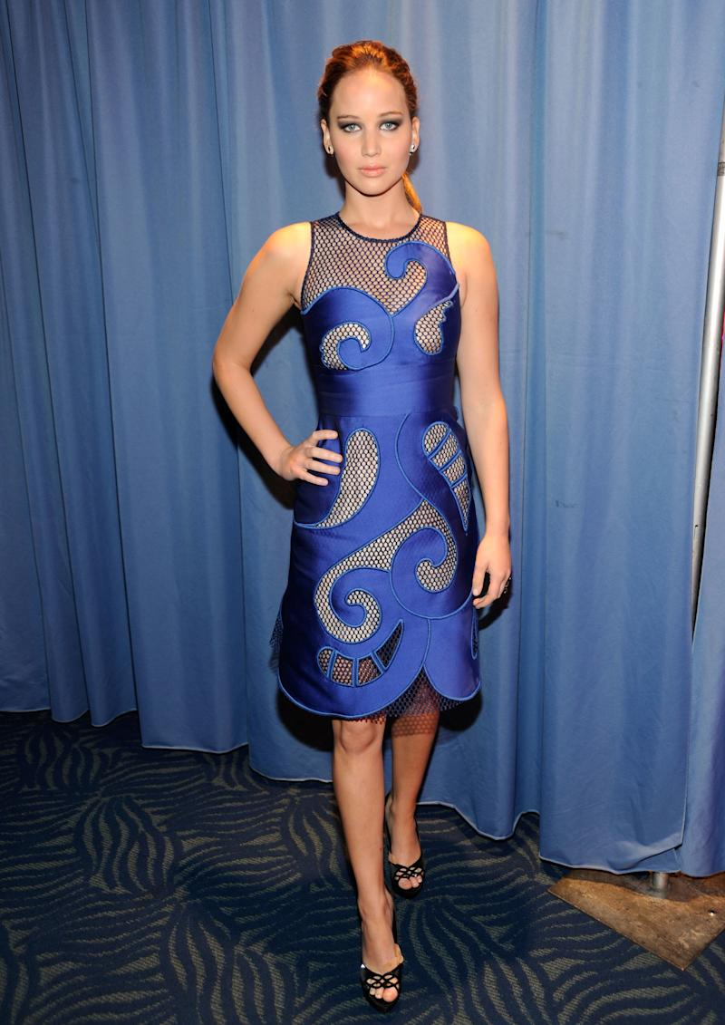 An edgier side of Lawrence emerged as she attended the People's Choice Awards in Los Angeles wearing a daring Viktor and Rolf dress with mesh cutouts and wave designs.