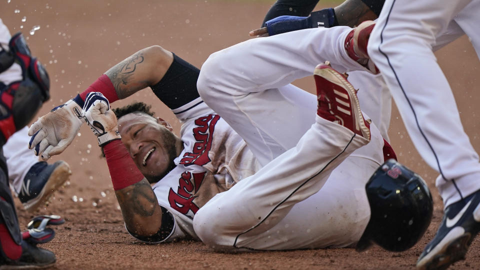 Cleveland Indians' Harold Ramirez is mobbed by teammates after they defeated the Seattle Mariners in 10 innings in a baseball game, Saturday, June 12, 2021, in Cleveland. (AP Photo/Tony Dejak)