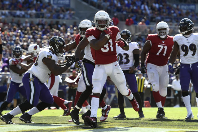Arizona Cardinals running back David Johnson (31) scores a touchdown in the second half of an NFL football game against the Baltimore Ravens, Sunday, Sept. 15, 2019, in Baltimore. (AP Photo/Gail Burton)