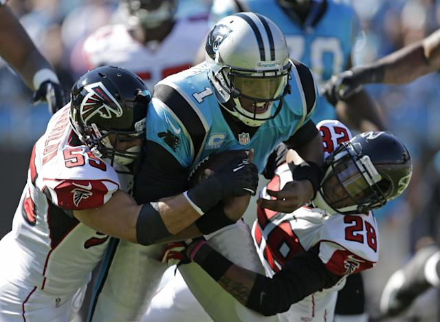 Carolina Panthers' Cam Newton (1) is sacked by Atlanta Falcons' Paul Worrilow (55) and Thomas DeCoud (28) in the first half of an NFL football game in Charlotte, N.C., Sunday, Nov. 3, 2013. (AP Photo/Bob Leverone)