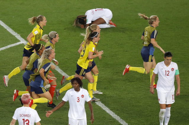 Sweden players run to their goalkeeper celebrating at the end of the Women's World Cup round of 16 soccer match between Sweden and Canada at the Parc des Princes in Paris, France, Monday, June 24, 2019. Sweden won 1-0. (AP Photo/Michel Euler)