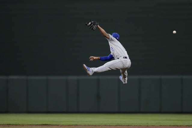 Kansas City Royals third baseman Cheslor Cuthbert leaps but is unable to catch a single by Baltimore Orioles' DJ Stewart during the second inning of a baseball game, Wednesday, Aug. 21, 2019, in Baltimore. (AP Photo/Julio Cortez)