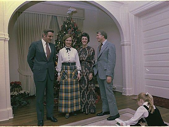 Jimmy Carter and Rosalynn Carter with Walter Mondale and Joan Mondale for dinner at the Vice-President's residence.