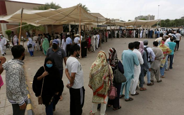 People queue to receive their first shot of the Sinovac Covid-19 vaccine at a vaccination centre in Karachi, Pakistan, on June 4 2021 - Fareed Khan/AP