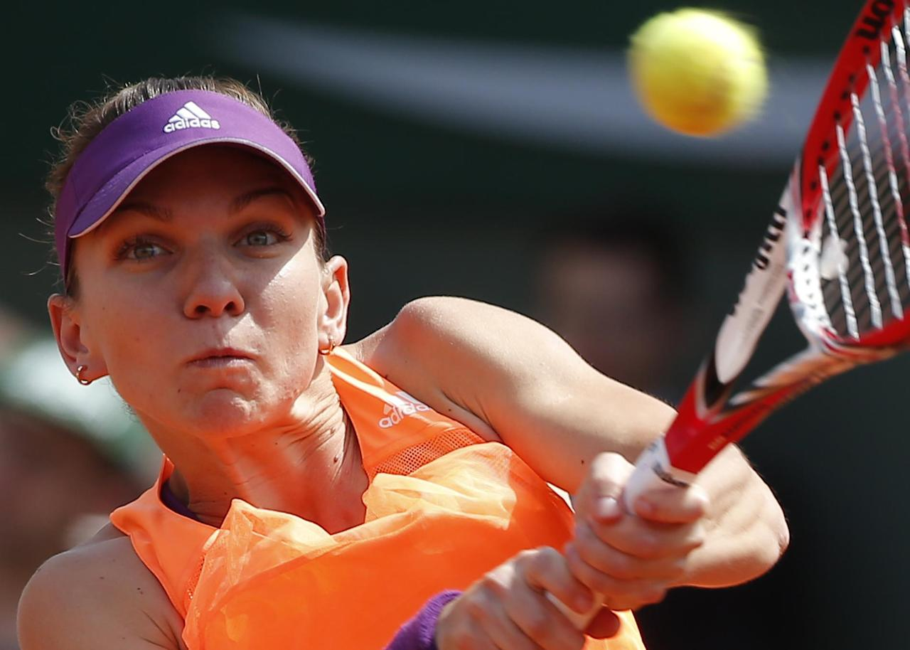 Romania's Simona Halep returns the ball to Russia's Maria Sharapova during their final match of the French Open tennis tournament at the Roland Garros stadium, in Paris, France, Saturday, June 7, 2014. (AP Photo/Michel Euler)