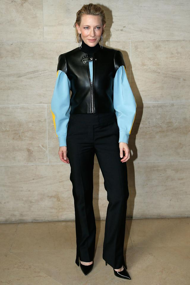 <p><strong>3 October</strong> Cate Blanchett opted for a black, blue and yellow leather jacket with trousers for the show. </p>