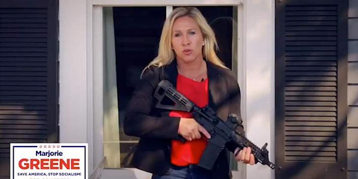 """Republican congressional candidate Marjorie Taylor Greene brandishes an AR-15 while defending property against nonexistent """"antifa"""" activists in a promotional video. (Photo: Marjorie Taylor Greene/YouTube)"""