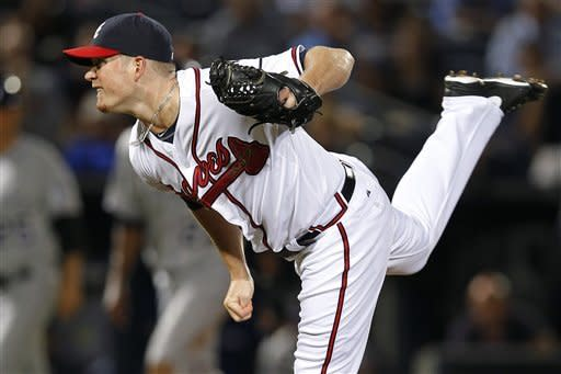 Atlanta Braves relief pitcher Craig Kimbrel (46) works in the eighth inning of a baseball game against the Colorado Rockies, Wednesday, Sept. 5, 2012, in Atlanta. (AP Photo/John Bazemore)