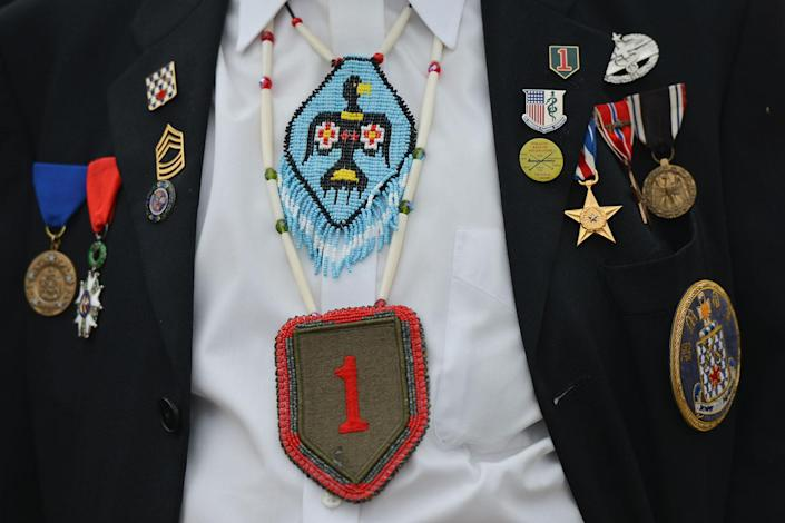 <p>Charles Norman Shay, 92, a Penobscot tribal elder and a veteran from WWII, returns to Omaha beach for the 73rd anniversary of D-Day. (Photo: Artur Widak/NurPhoto via Getty Images) </p>