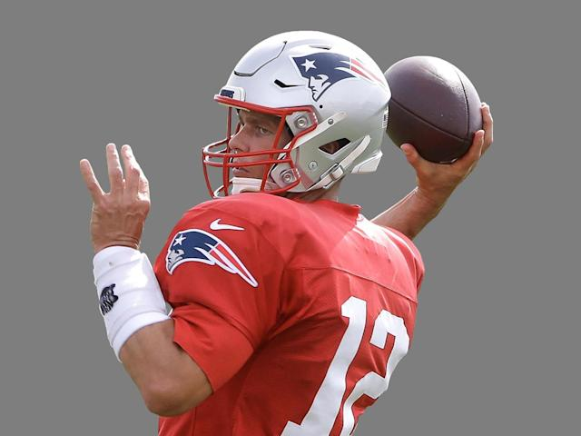 Tom Brady at practice this month, wearing a new approved helmet. (AP)