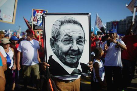 A person carries a picture of Cuban President Raul Castro during a May Day rally in Havana, Cuba, May 1, 2017. REUTERS/Alexandre Meneghini/Files