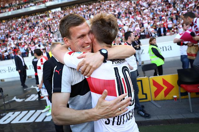 Football Soccer - VfB Stuttgart v Wurzburger Kickers - 2. Bundesliga - Mercedes-Benz Arena, Stuttgart, Germany - 21/5/17 VfB Stuttgart coach Hannes Wolf celebrates promotion with Alexandru Maxim after the matach Reuters / Kai Pfaffenbach Livepic DFL RULES TO LIMIT THE ONLINE USAGE DURING MATCH TIME TO 15 PICTURES PER GAME. IMAGE SEQUENCES TO SIMULATE VIDEO IS NOT ALLOWED AT ANY TIME. FOR FURTHER QUERIES PLEASE CONTACT DFL DIRECTLY AT + 49 69 650050.