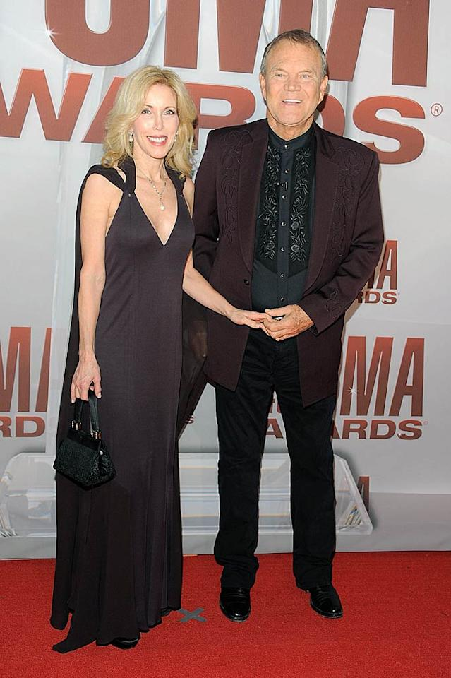 Singer Glen Campbell and wife Kimberly Woolen were color-coordinated in countrified dark purple getups. (11/9/2011)
