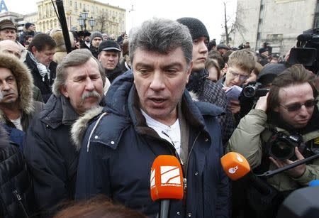 Opposition leader Boris Nemtsov speaks to the media during a gathering of opposition supporters in central Moscow March 17, 2012.  REUTERS/Mikhail Voskresensky/Files