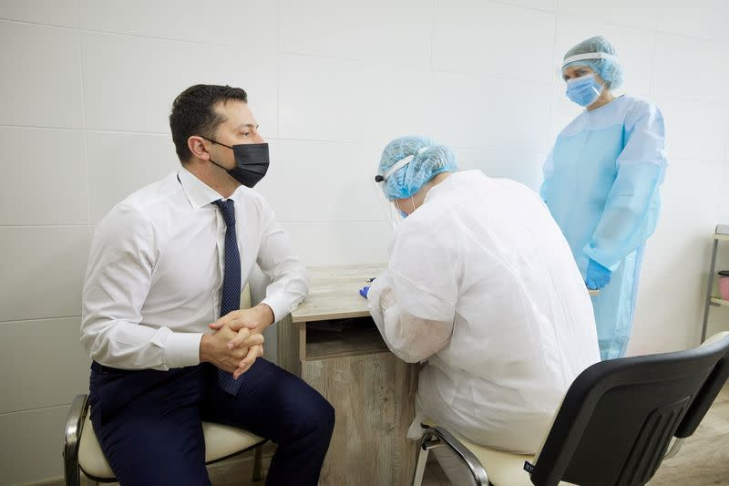 FILE PHOTO: Ukraine's President Zelenskiy waits before receiving a dose of a vaccine against the coronavirus disease in Luhansk Region