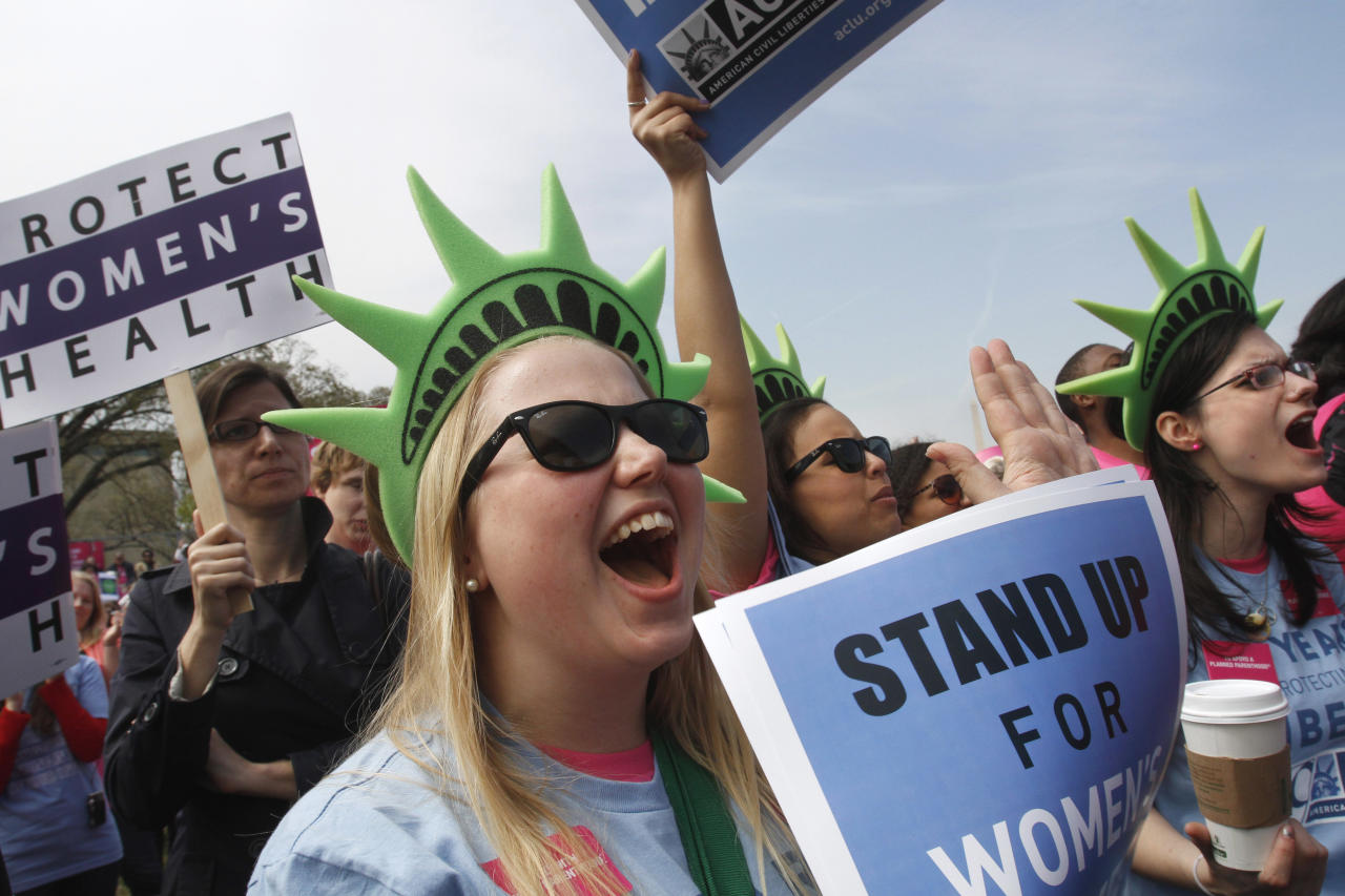Nellie Stagg, 19, from the University of Connecticut, takes part in rally in support of Planned Parenthood, Thursday, April 7, 2011, on the National Mall in Washington.