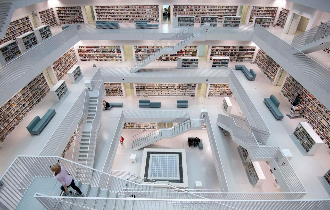 """<p>The gleaming white surfaces and crisp lines create a dreamy and relaxed atmosphere within the <a href=""""http://www1.stuttgart.de/stadtbibliothek/bvs/actions/profile/view.php?id=159"""">Stuttgart City Library</a>. Taking design cues from the Pantheon in Rome, German-based <a href=""""https://www.yiarchitects.com/"""" target=""""_blank"""">Yi Architects</a> took a minimalist approach towards designing the nine-story library with an open multi-floor reading room shaped like an upside-down pyramid. The only color within the cube building comes from the thousands of books that line the shelves.</p>"""