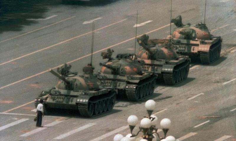 A man stands alone to block a line of tanks during Tiananmen Square protests on 5 June, 1989.