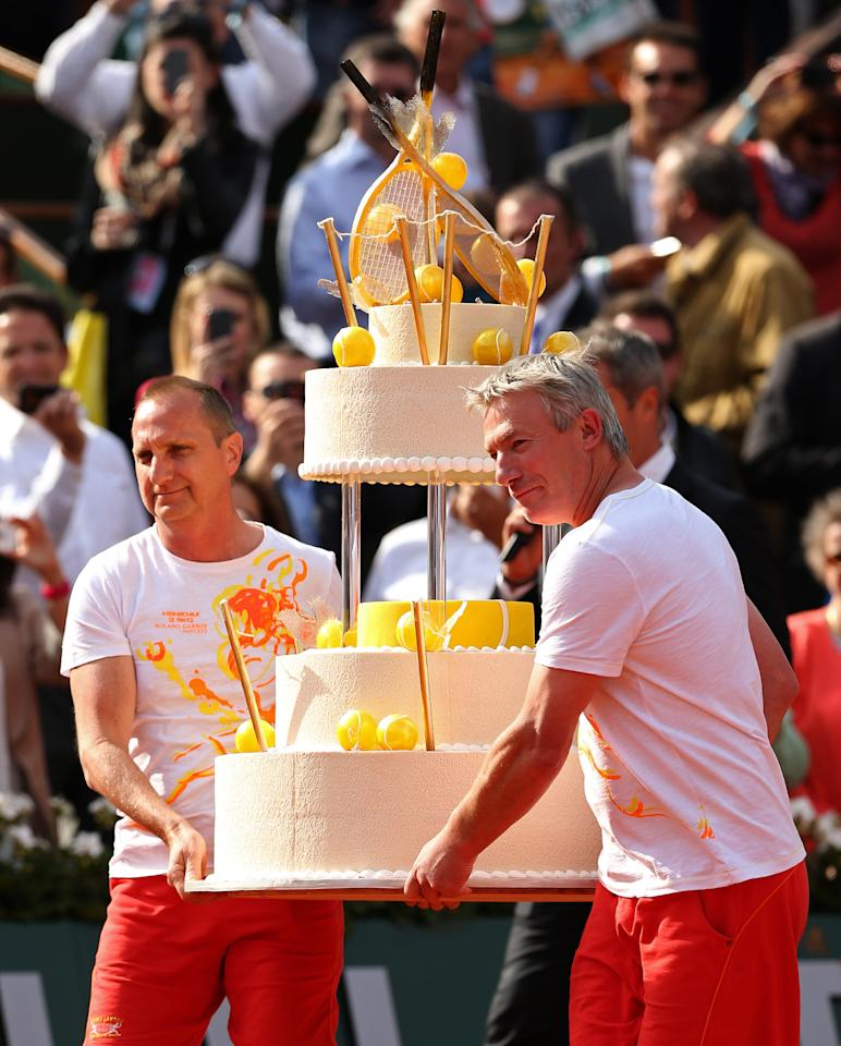 PARIS, FRANCE - JUNE 03: A giant birthday cake is carried onto the court for Rafael Nadal of Spain after his victory in the Men's Singles match against Kei Nishikori of Japan during day nine of the French Open at Roland Garros on June 3, 2013 in Paris, France. (Photo by Matthew Stockman/Getty Images)