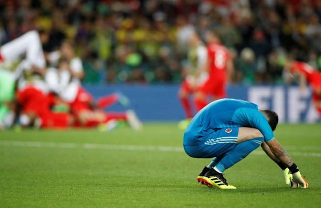 <p>Colombia's David Ospina looks dejected after losing the penalty shootout. REUTERS/Carl Recine </p>