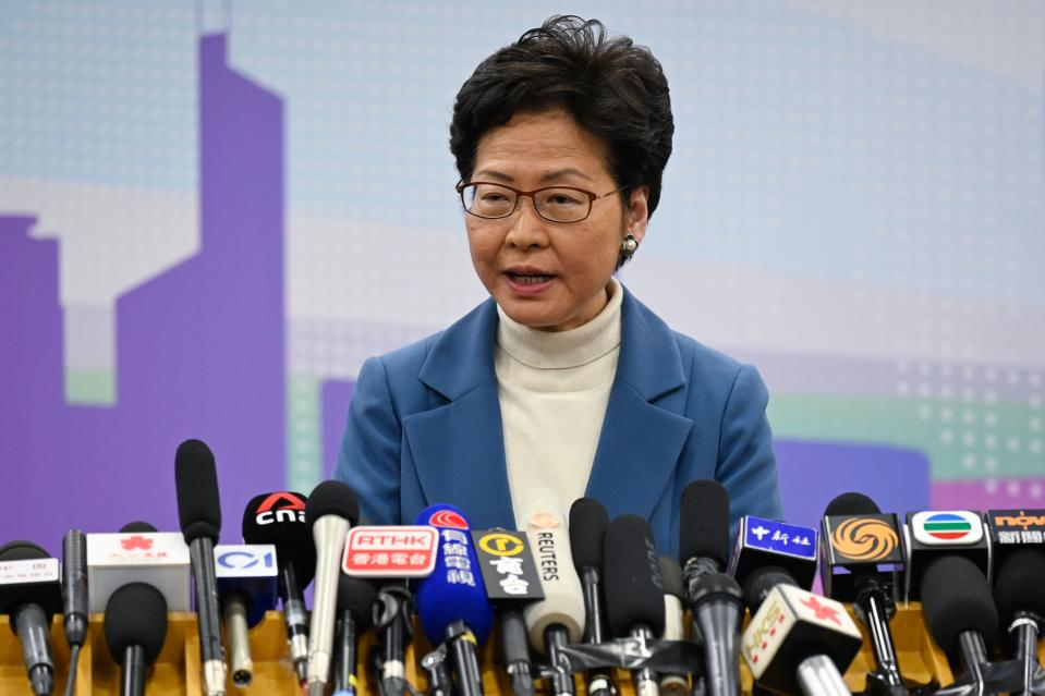 "Hong Kong's Chief Executive Carrie Lam attends a press conference in Beijing on December 16, 2019. - Chinese President Xi Jinping told beleaguered Hong Kong leader Carrie Lam on December 16 that she had Beijing's ""unwavering support"" after another huge pro-democracy rally earlier this month and her government's thrashing at recent local elections. (Photo by WANG ZHAO / AFP) (Photo by WANG ZHAO/AFP via Getty Images)"